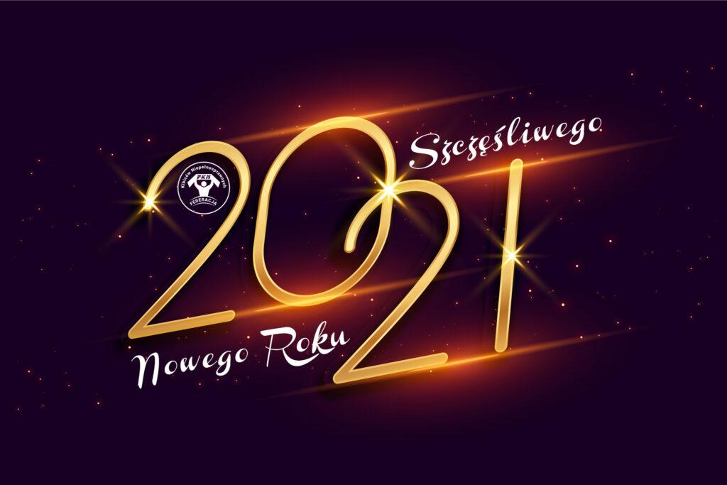 Ciemne tło a na nim duże złote cyfry 2021 i napis Szczęśliwego Nowego Roku